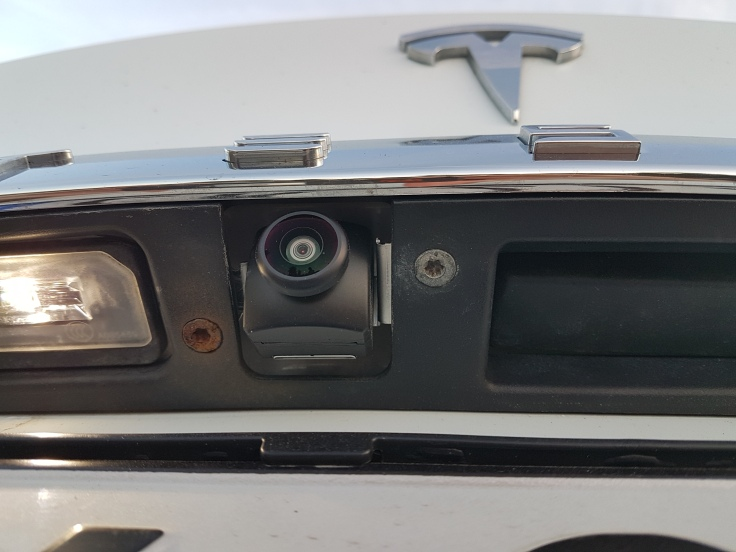 Tesla rear camera screw rusting August 2018